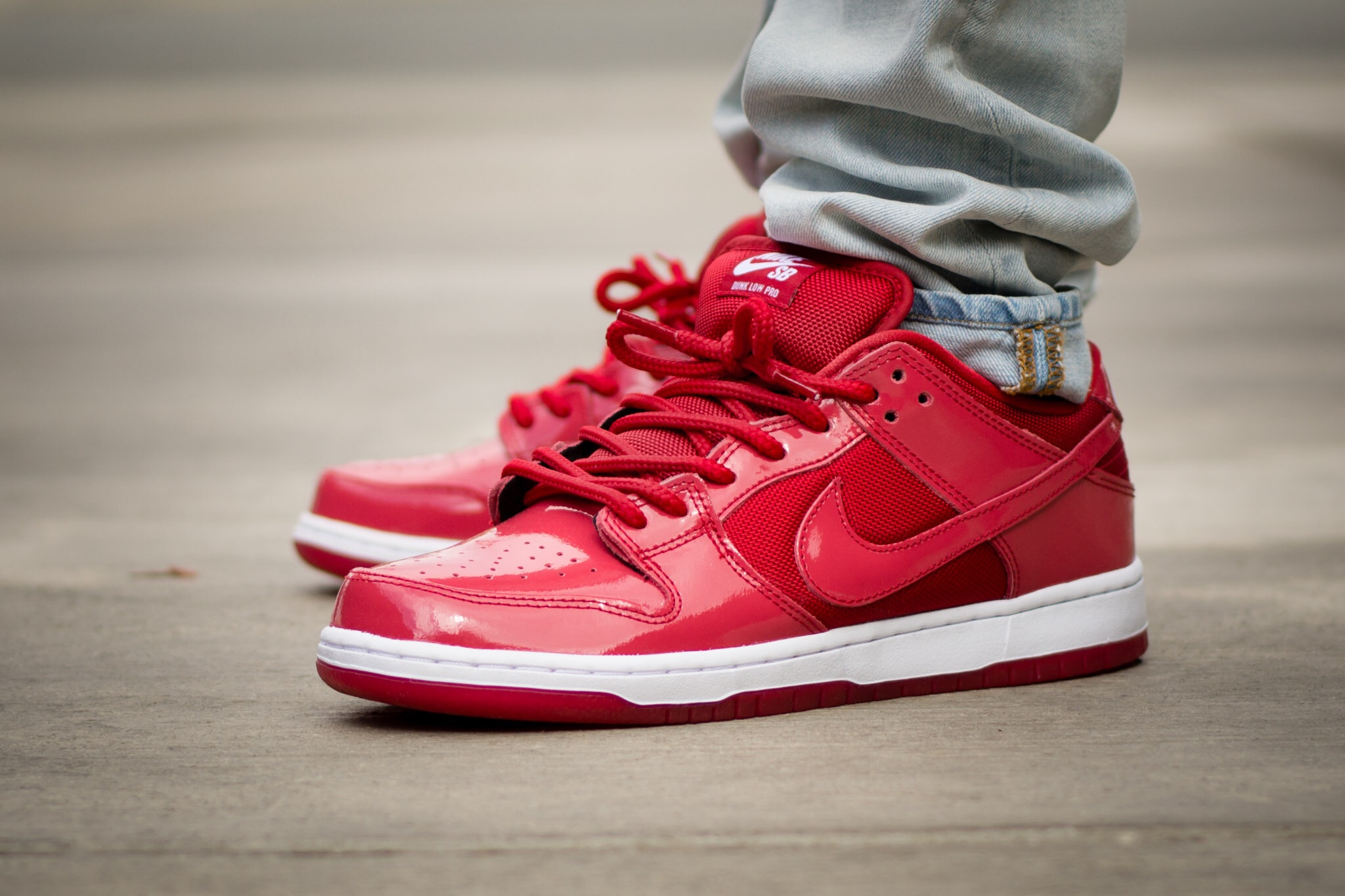 separation shoes 82b98 b44a1 Nike Dunk SB Low Ruby Red Slipper - WDYWT